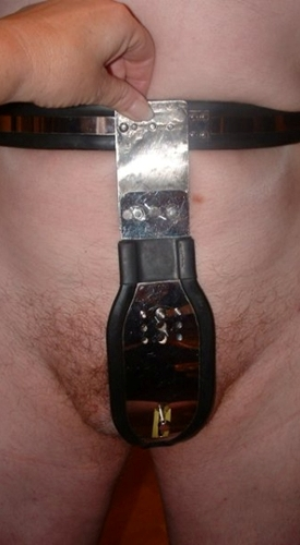 A slave wearing a chastity device